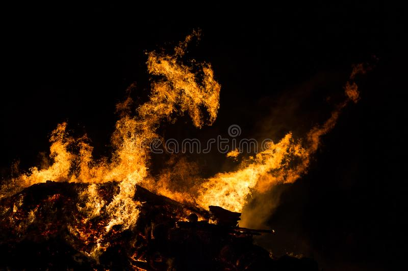 Fire Dragon. A bonfire forms the shape of a dragon royalty free stock image