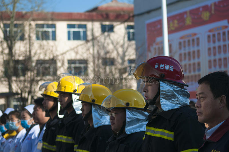 Fire emergency rescue drill. November 28, 2013 morning, baixiang County Middle School held a stampede of fire and emergency exercises. The exercise simulated a royalty free stock photo