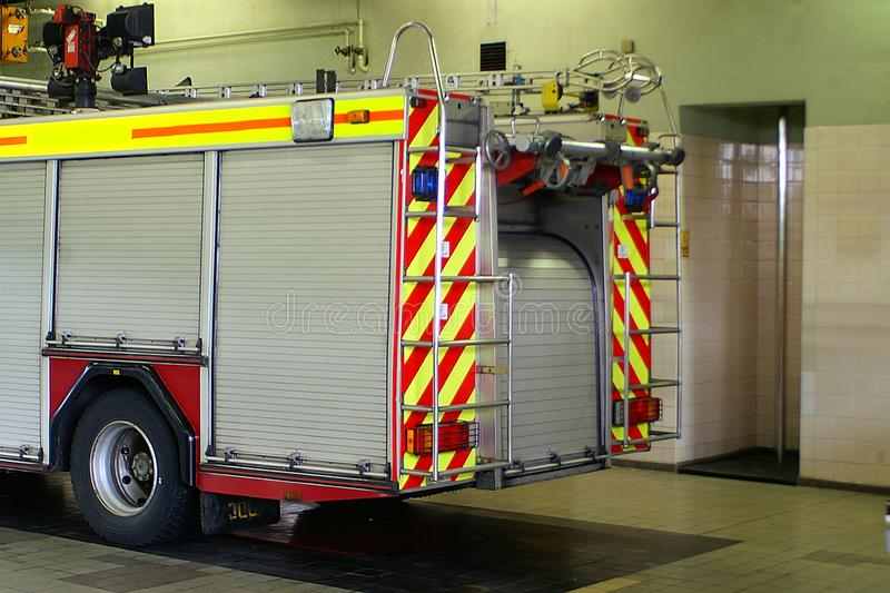 Fire engine on blue light. Fire engine attending an incident on blue light, emergency responder stock image