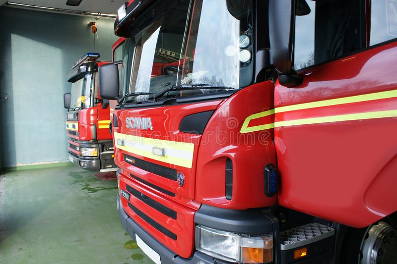 Fire engine in fire station. In standby for incident or fire, community protection royalty free stock photo
