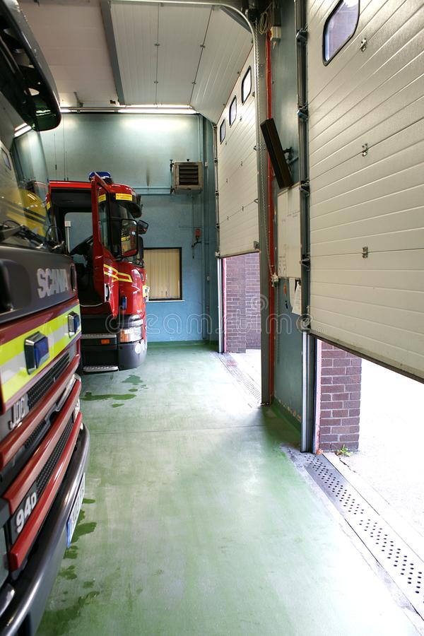 Fire engine in fire station. In standby for incident or fire, community protection royalty free stock images