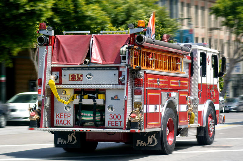 Fire Engine Truck of San Francisco Fire Department (SFFD). SAN FRANCISCO - MAY 21 2015:SFFD Truck E35 operating at a fire in the Tenderloin.San Francisco Fire stock photo
