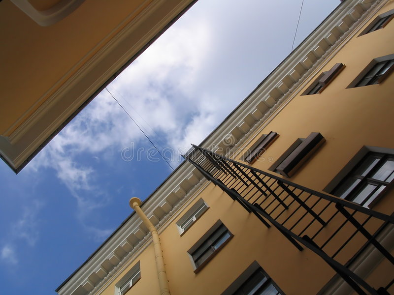 Download Fire-escape stock photo. Image of blue, wall, pane, yellow - 113128