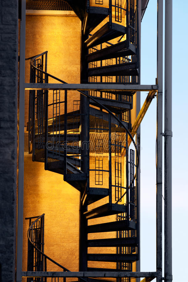 Fire escape. On block of flats or hotel in electric light stock photos