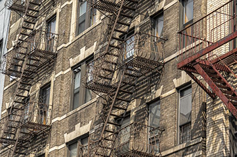 Fire escape ladder in new york city building stock images
