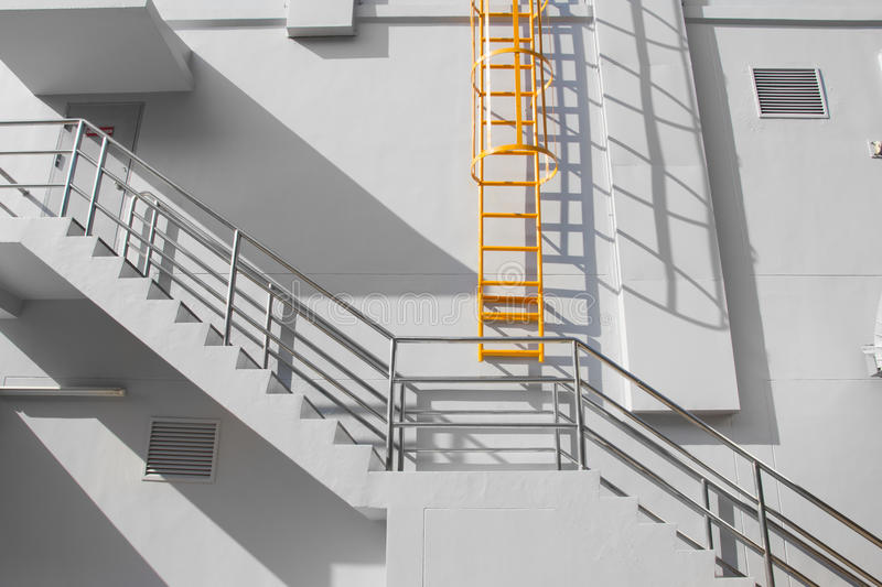 Fire escape ladder. On the side of building stock photos