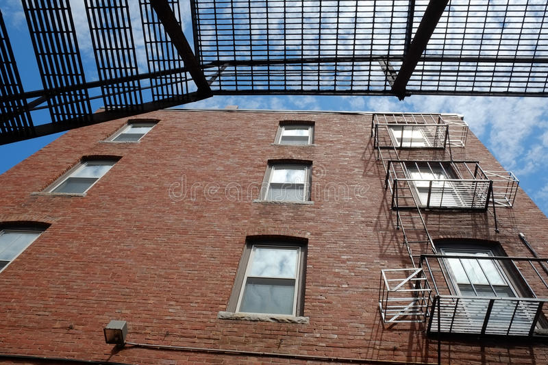 Fire escape ladders on the outside of a building stock images