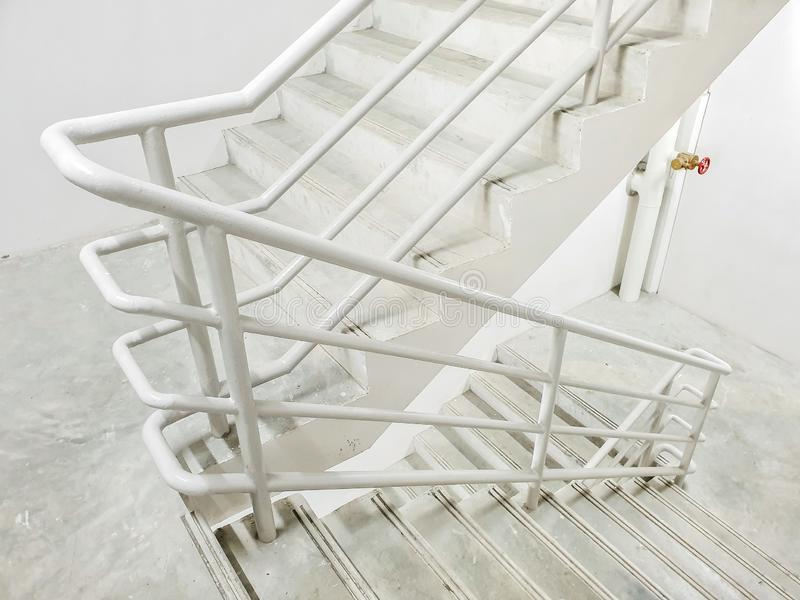 Fire escape ladders. At the parking lot in the mall.Staircase cement in the parking in shopping mall.iron railing, mallstaircase, malliron stock photos