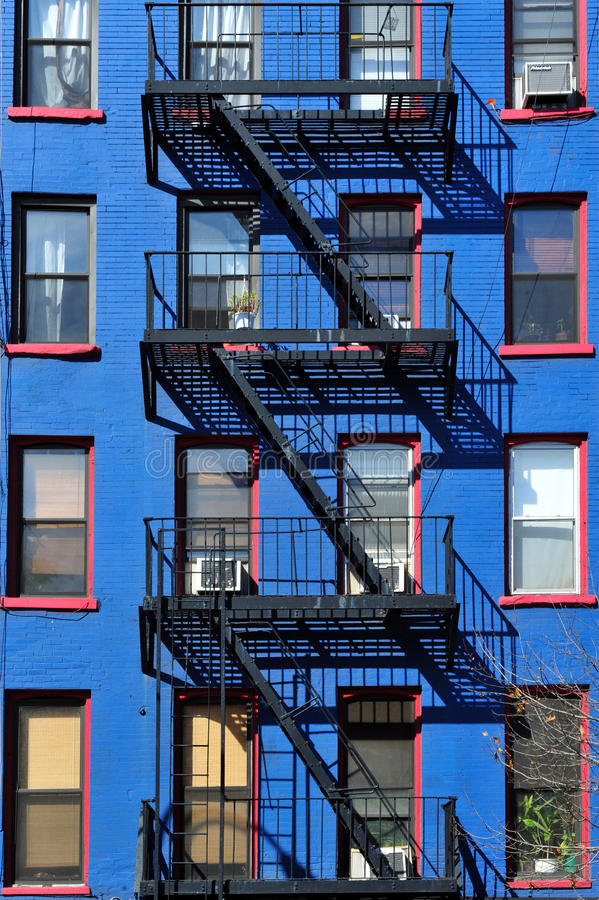 Fire escape new york building. A fire escape of the facade of an apartment building in Manhattan in New York city royalty free stock photography