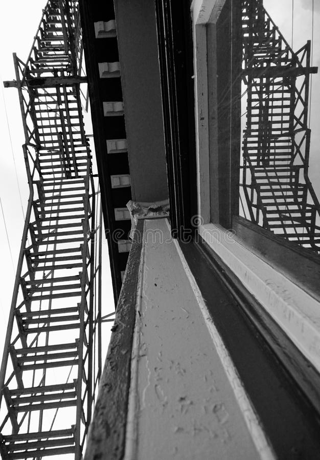 A fire escape off a balcony in The Flats - Cleveland - Ohio - USA stock image