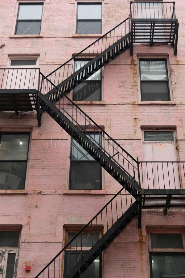 Fire Escape on an Old Pink Building in New York City royalty free stock images