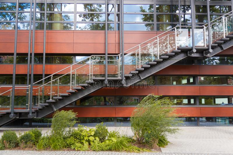 Fire escape staircase emergency exit on the background of the modern building facade.  royalty free stock photos
