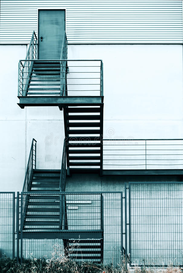 Fire escape staircase in a modern building. Industrial structure with emergency metal stair / Fire escape staircase in a modern building stock image