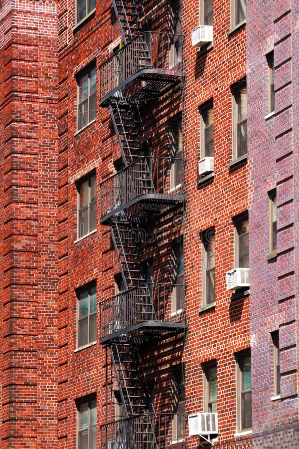 Fire Escape stairs on the building wall in New York City royalty free stock photos