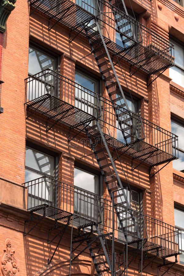 Fire escape stairs in Manhattan New York City, USA stock photos