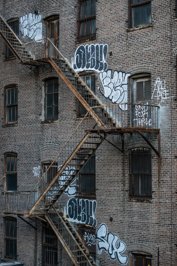 Fire escape stairs on an old building exterior in New York, Manhattan.  royalty free stock photography
