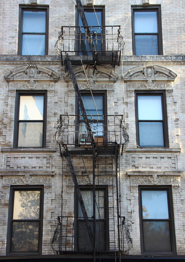 Free Fire Escape Steel Ladder On White Apartment Building Facade Royalty Free Stock Image - 62900326