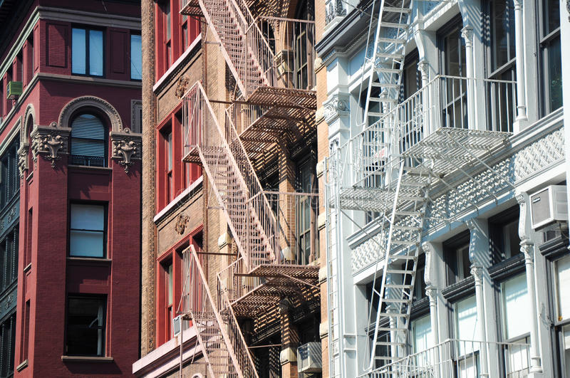 Fire escapes, NYC. Fire escapes of tenement style apartment buildings in Manhattan, New York City stock image