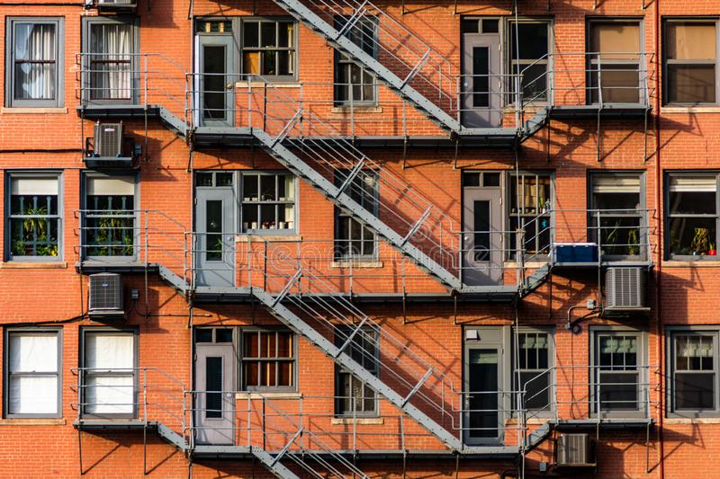 Fire Escapes on the side of an Old Skyscraper stock photos