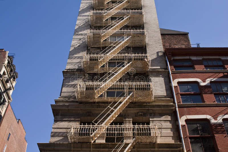 Fire Escpaes in New York City. Shot from a street view stock image