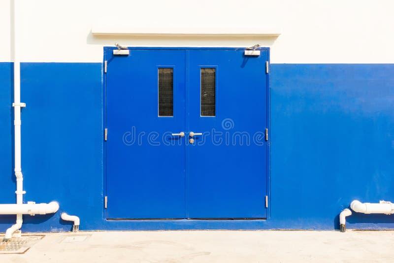 Fire exit door of warehouse building., Steel doors. stock image