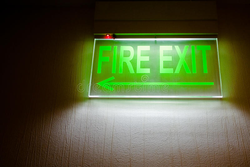 Fire Exit Sign. Green fire exit sign in a hotel stock photos