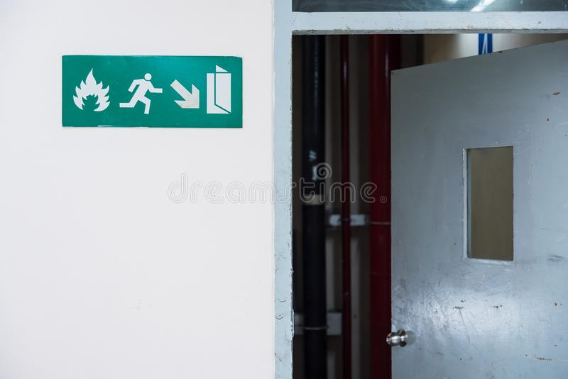 Fire exit sign in the airport terminal emergency exit way.Thailand. royalty free stock photography