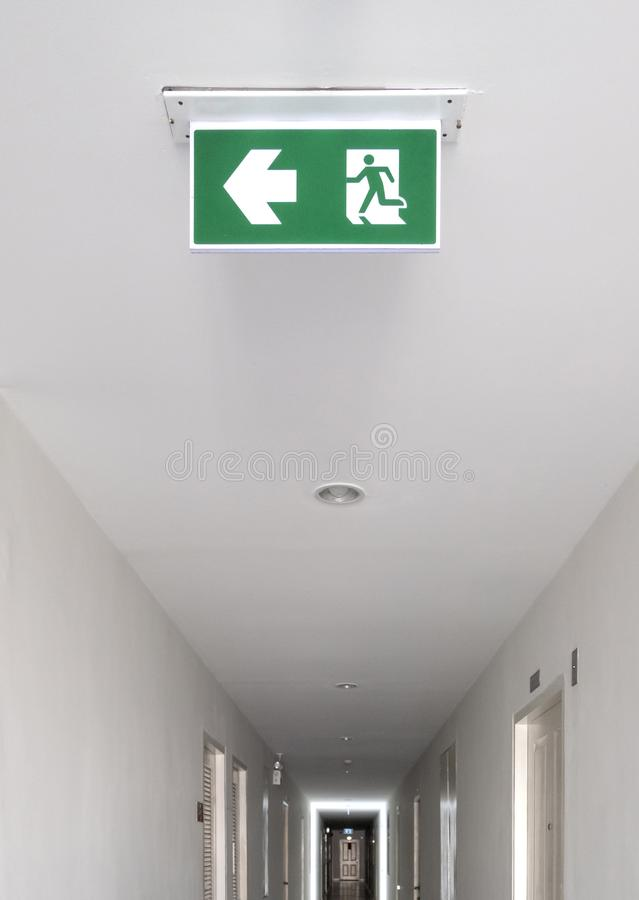 Fire exit sign. Emergency fire exit door exit door on ceiling royalty free stock images