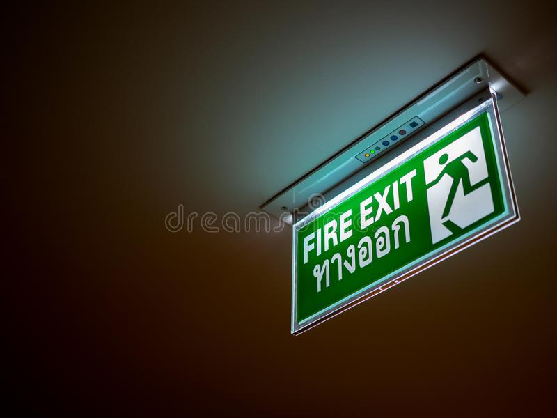 Fire exit sign stock photos