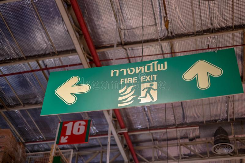 Fire exit sign. way to escape of danger royalty free stock images