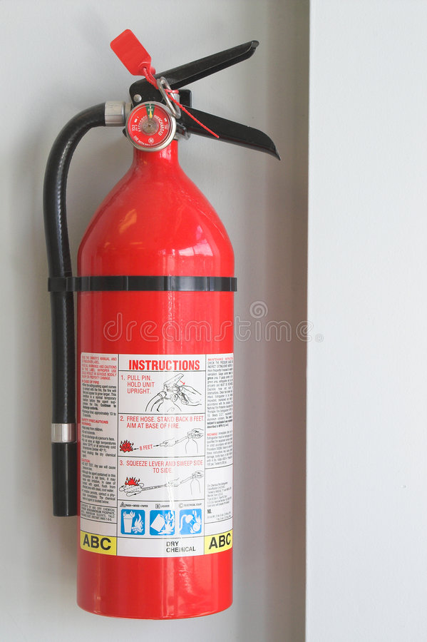 Fire Extinguisher. A fire extinguisher mounted to a wall royalty free stock photo