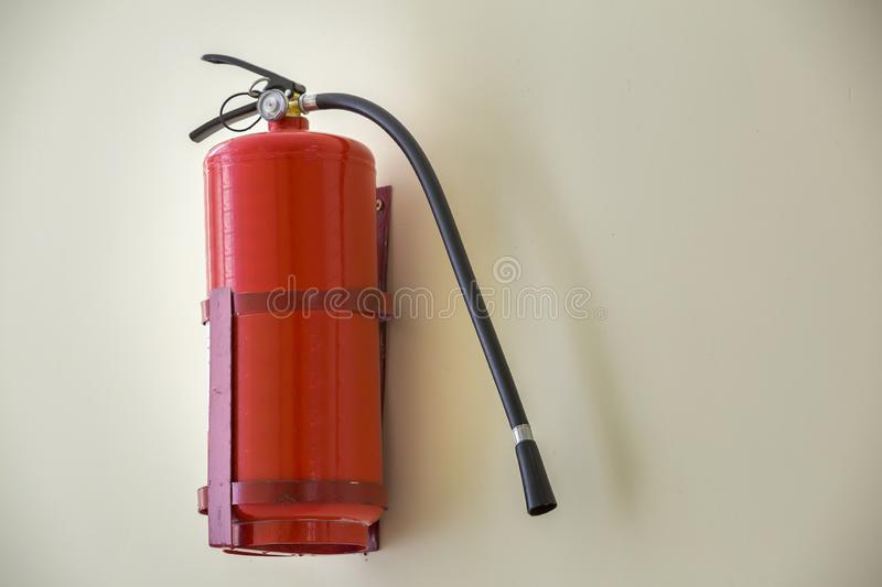 Fire extinguisher bright red isolated on white wall copy space background. Danger and safety, fire protection concept.  stock images