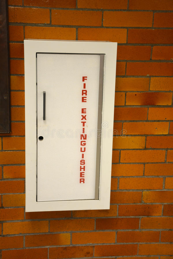Fire extinguisher door royalty free stock photography