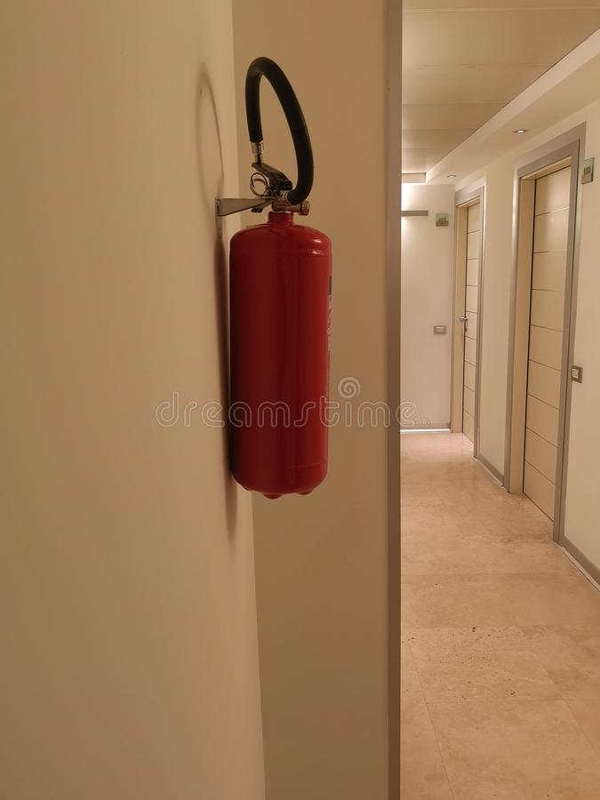 Fire extinguisher in the hotel corridor. Red stock images
