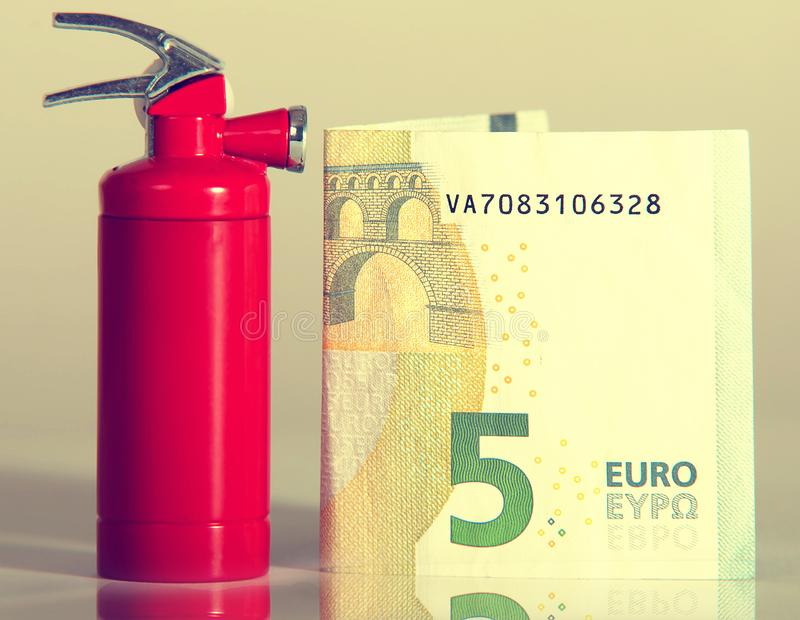 Fire extinguisher, money, lighter royalty free stock photos