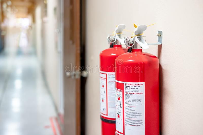 Fire extinguisher system on the wall background, powerful emergency equipment royalty free stock images