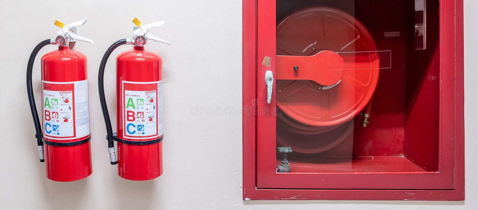 Fire extinguisher system on the wall background, powerful emergency equipment for industrial stock image