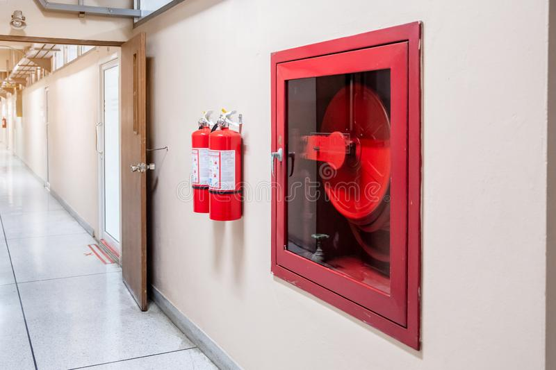 Fire extinguisher system on the wall background, powerful emergency equipment for industrial royalty free stock images