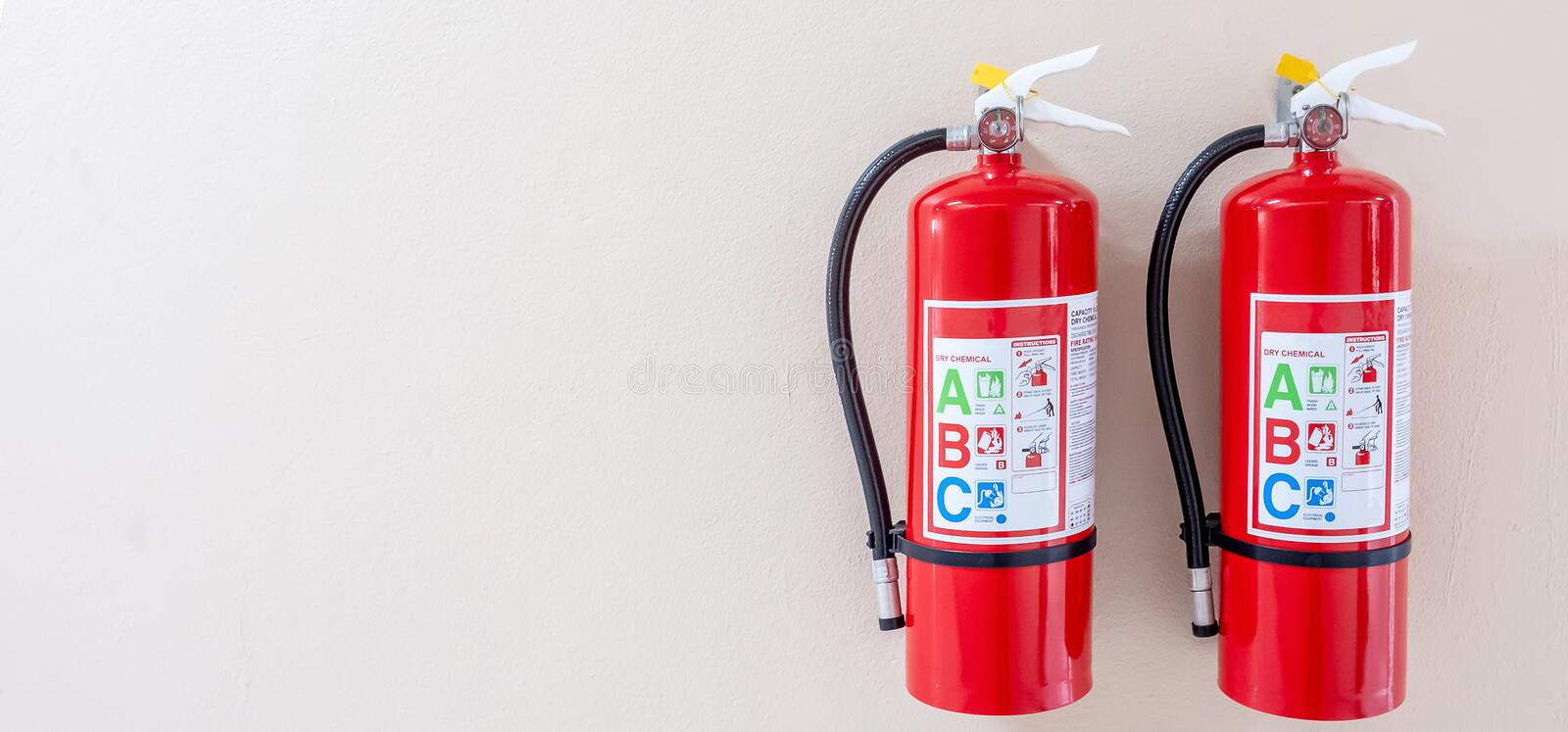 Fire extinguisher system on the wall background, powerful emergency equipment for industrial stock photos