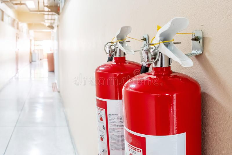 Fire extinguisher system on the wall background, powerful emergency equipment for industrial stock photography