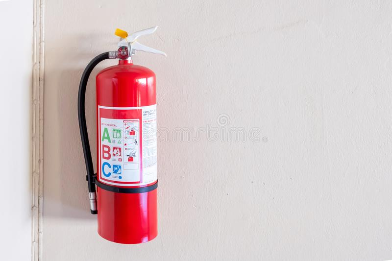 Fire extinguisher system on the wall background, powerful emergency equipment for industrial royalty free stock photos