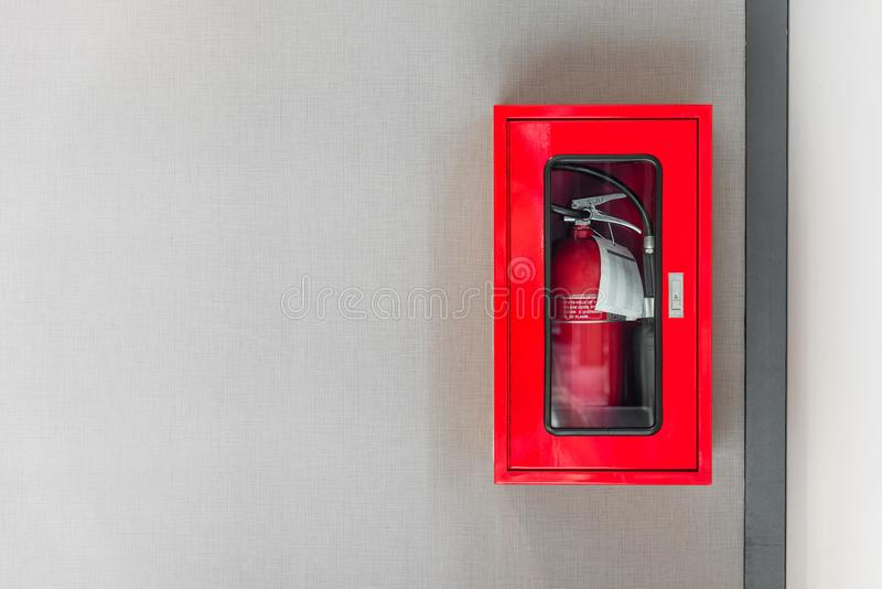 Fire extinguishers cabinet on grey wall stock image