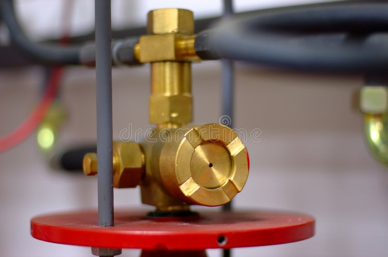 Fire extinguishing valve. A cooper valve of a fire extinguishing system in a telecommunication equipment hall royalty free stock photo