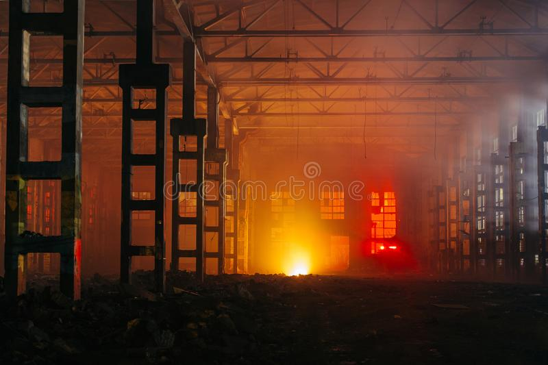 Fire in the factory. Burning industrial building interior stock photo