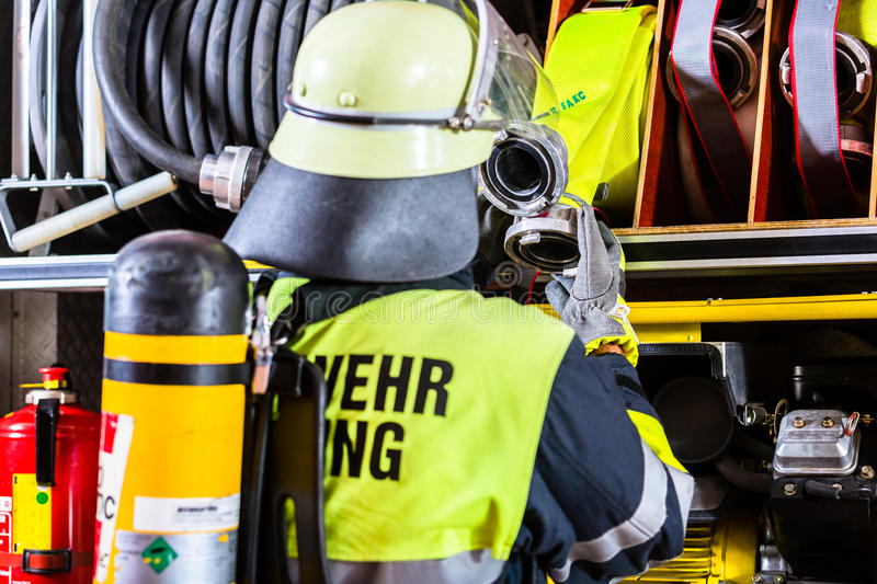 Fire fighter with breathing protection and oxygen tank royalty free stock photos