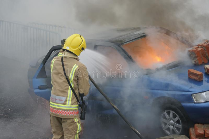 Fire fighter, car fire royalty free stock images