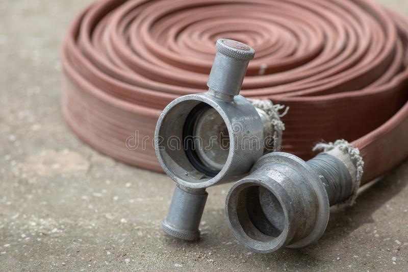 Fire fighter hose ready to use in the outdoor.  stock photo