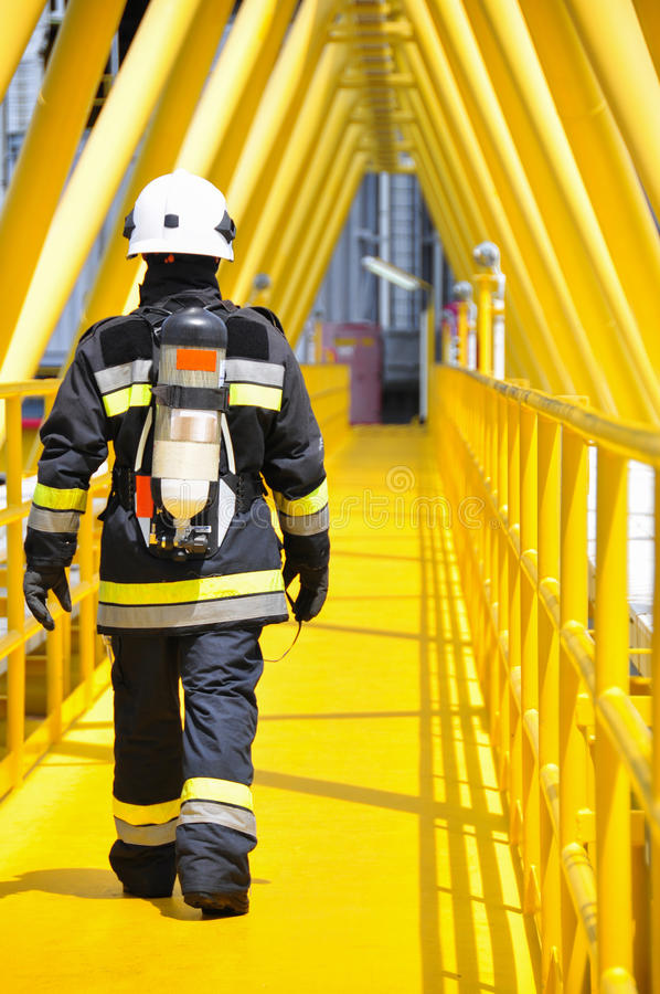 Fire fighter on oil and gas industry, successful firefighter at work. Fire fighter on oil and gas industry, successful firefighter at work royalty free stock image