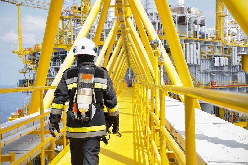 Fire fighter on oil and gas industry, successful firefighter at work. stock photos