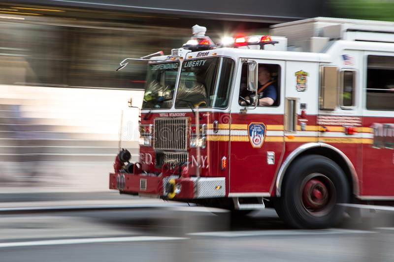 Fire fighter truck on emergency. On the streets of Manhattan New York royalty free stock image